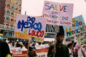 Banners and bright colour signs from the mad pride parade in Salvador, Brazil