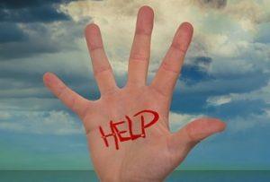 Hand reaching to help volunteer