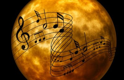 Image: Music Notes Floating Over a Yellow Moon