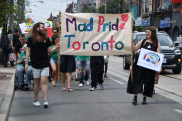 Mad Pride Banner at front of parade